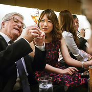 Cellar master Hervé Deschamps of champagne Perrier-Jouët introduces his champagne to an escort lady during a market visit in a Japanese nightclub. Founded in 1811 in Epernay, Maison Perrier-Jouët is one of France's most historic champagne houses, but also one of its most distinctive, renowned for its floral and intricate champagnes which reveal the true essence of the Chardonnay grape. Started in 1811, its cellars holds the world's two oldest known bottles of champagne, the 1825 vintage.