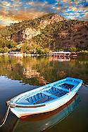 Ferry row boat on the Dalyan Çay? River looking towards boats & fish restaurant. Mediterranean coast Turkey