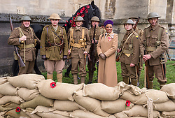 "© Licensed to London News Pictures. 27/10/2018. Bristol, UK. Picture of PEACHES GOLDING the Lord Lieutenant of Bristol with Somerset Light Infantry re-enactors at the Royal British Legion launch this year's Bristol Poppy Appeal, ""One thousand poppies, for one hundred years, for one million lives"" at Bristol Cathedral. For the launch of the 2018 Bristol Poppy Appeal at 11am on 27 October, the Royal British Legion recreated a scene from the end of WW1 outside Bristol Cathedral on College Green, and Colonel Clive Fletcher-Wood read the war poem In Flanders Fields. They were joined by Civic Dignitaries Peaches Golding the Lord Lieutenant of Bristol, City of Bristol High Sheriff Mr Roger Opie, and Bristol's Lord Mayor Cleo Lake. A Bugler and the Bristol Military Wives Choir performed songs from their new album 'Remember'. Staff at MOD Filton filled 400 sandbags with eight tonnes of sand to build trenches and recreate 'Flanders Fields' and planted over 1000 waterproof poppies on College Green. Poppies and sandbags can be sponsored by individuals wanting to remember those who fought and died in conflict. There were re-enactors in WW1 uniform from Somerset Light Infantry (known as the West Country Tommys), as well as medics and nurses with equipment from the time. Bristol's own 'War Horse' (Buzz from Blagdon Horsedrawn Carriages) was on College Green behind the improvised barbed wire to represent the 350,000 horses that left Avonmouth for the frontline during WW1. There are also 10,000 knitted poppies on display both in and outside Bristol Cathedral following 'The Charfield Yarn Bombers' incitement to locals to get knitting to mark the occasion, with a display inside the Cathedral organised by Helen Date. Photo credit: Simon Chapman/LNP"