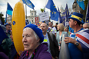 Anti Brexit protesters with messages against Boris Johnson and the Tory government to Stop Brexit, Stop the Coup and Pro Democracy at a demonstration organised by Peoples Vote in Westminster on the day that Parliament reconvenes after summer recess to debate and vote on a bill to prevent the UK leaving the EU without a deal at the end of October, on 3rd September 2019 in London, England, United Kingdom. Today Prime Minister Boris Johnson will face a showdown after he threatened rebel Conservative MPs who vote against him with deselection, and vowed to aim for a snap general election if MPs succeed in a bid to take control of parliamentary proceedings to allow them to discuss legislation to block a no-deal Brexit. Peoples Vote is a United Kingdom campaign group calling for a public vote on the final Brexit deal between the United Kingdom and the European Union.