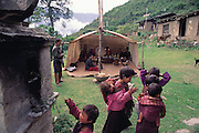 As happens in every Bhutanese village each year, a two-day ceremony is held to bless the village of Shingkhey. To a continuous background of chanting, the monks fill the valley with long, slow, deep notes from their horns. From Peter Menzel's Material World Project.