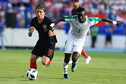 OSIJEK, June 08, 2018  Luka Modric (L) of Croatian national team competes against Idrissa Gana Gueye (R) of Senegal national team during the International friendly match ahead of the FIFA World Cup in Russia, in Osijek, Croatia, on June 08, 2018. Croatia won 2-1. (Credit Image: © Davor Javorovic/Pixsell/Xinhua via ZUMA Wire)