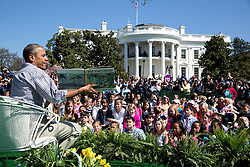 """President Barack Obama reads """"Where the Wild Things Are"""" by Maurice Sendak to children during the annual Easter Egg Roll on the South Lawn of the White House, April 6, 2015. (Official White House Photo by Pete Souza)<br /> <br /> This official White House photograph is being made available only for publication by news organizations and/or for personal use printing by the subject(s) of the photograph. The photograph may not be manipulated in any way and may not be used in commercial or political materials, advertisements, emails, products, promotions that in any way suggests approval or endorsement of the President, the First Family, or the White House."""