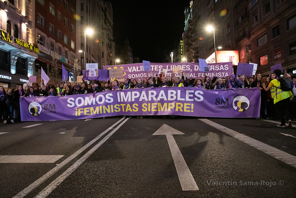 """Madrid, Spain. 8th March, 2019. Demonstrators at Gran Via street carrying the main banner of the demonstration with the moto 'We are unstoppable, feminist always"""" during the demonstration held in Madrid during the celebrations of the International Women's Day. © Valentin Sama-Rojo"""
