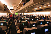 on board a commercial flight Economy class