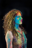 Woman Woman with colorful holifest paint on her face. Holi is the festival of love or colors that signifies the victory of superior over immoral.