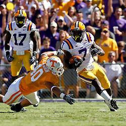 Oct 2, 2010; Baton Rouge, LA, USA; LSU Tigers cornerback Patrick Peterson (7) runs past Tennessee Volunteers linebacker Austin Johnson (40) on a punt return during the first half at Tiger Stadium.  Mandatory Credit: Derick E. Hingle