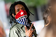 A demonstrator wearing face covering that reads 'free west papua' during the AFP Stop Training Killers protest organised by Make West Papua Safe organisation. The organisation believes the AFP trains with Indonesian riot police BriMob and counter-terrorist police D88, who are reportedly notorious killers in West Papua, responsible for execution-style murders, torture and other crimes. (Photo by Mikko Robles/Speed Media)