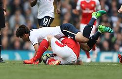 30 April 2017 London : Premier League Football : Tottenham Hotspur v Arsenal :<br /> Heung-Min Son of Tottenham lands on Granit Xhaka of Arsenal .<br /> Photo: Mark Leech