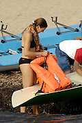 San Remo, ITALY,  Sat.  W4X+, Cox checks the life jackets before the women's Quadruple sculls  final, from the beach, 2008 FISA Coastal World Championships. Saturday 18/10/2008.[Photo, Peter Spurrier/Intersport-images] Coastal Rowing Course: San Remo Beach, San Remo, ITALY Equipment