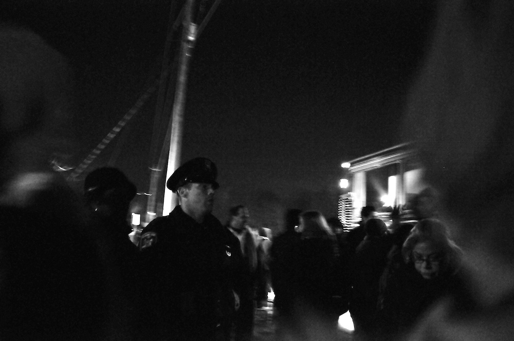 A police officer on patrol in a crowd of shoppers Black Friday Nov. 28 2008.