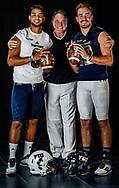 Butch Davis with quarterbacks Christian Alexander and James Morgan as they pose for a photograph at Riccardo Silva Stadium on Wednesday, August 8, 2018.