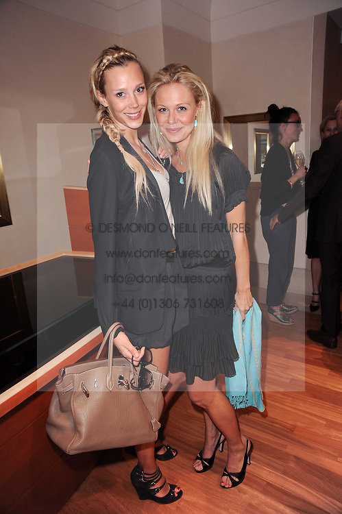 Left to right, LISA HENREKSON and ANNABEL WOLOWICZ at a party to celebrate the B.zero 1 design by Anish Kapoor held at Bulgari, 168 New Bond Street, London n 2nd June 2010.