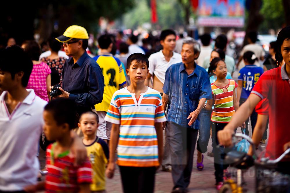 People walking around downtown Hanoi, Vietnam (tilt-shift