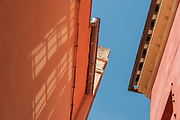 On my way to get a hair cut in Sevilla, Spain, I looked up and saw this image. I was moved by the color, the shapes, & the light reflecting in the shape of windows on the building's wall. So joyful!
