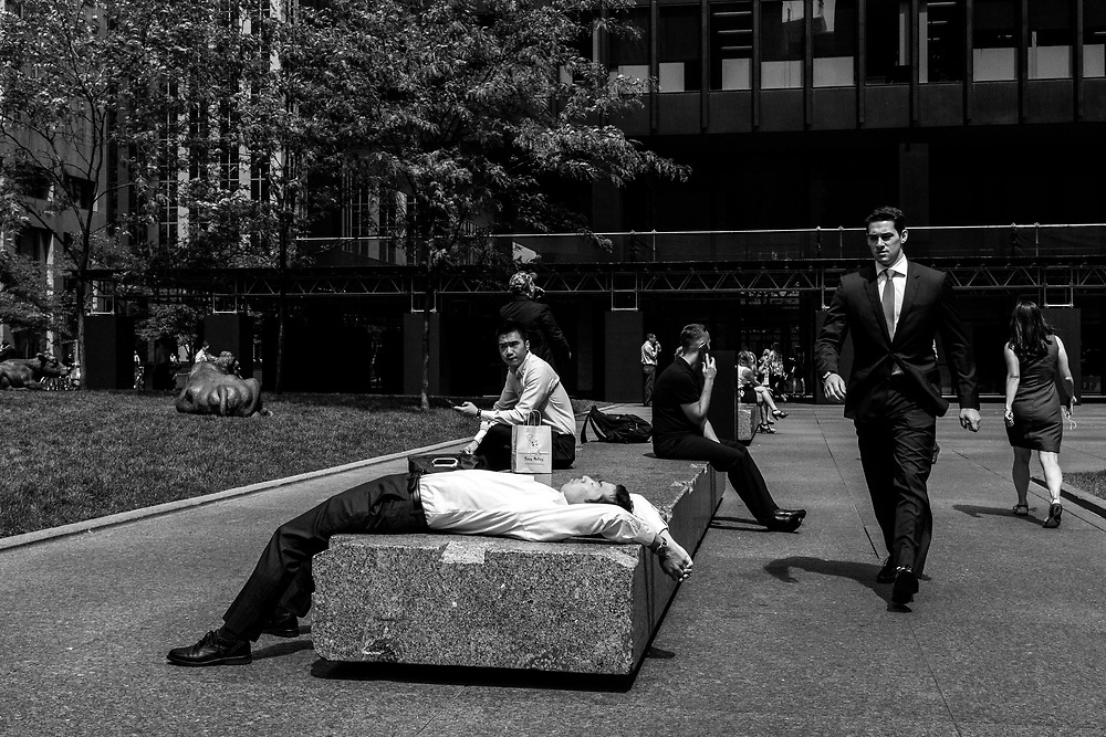 Lunchtime can also be a great time to catch people going about their business in the financial district. I photographed this man lying on the stone bench showing tiredness and even frustration. What caught my interest is the man walking towards him who appears to be his boss and appears to be confronting him. In reality the man walked right past him and had just given him a strange glance. It is his look of disgust and sternness on his face that gives this image a powerful assumption. The gesture of the lying man is just pure gold and one of those lucky finds when constantly walking the streets.