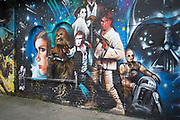 Star Wars street art on a wall in Shoreditch, London, UK. Graffiti in London is an ever changing visual enigma, as the artworks constantly change, as councils clean some walls or new works go up in place of others. While some consider this vandalism or graffiti, these artworks are very popular among local people and visitors alike, as a sense of poignancy remains in the work, many of which have subtle messages.