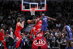 December 20, 2017 - Chicago, IL, USA - The Orlando Magic's Bismack Biyombo (11) guards the Chicago Bulls' Justin Holiday (7) while he passes the ball to teammate Robin Lopez (42) during the second half at the United Center in Chicago on Wednesday, Dec. 20, 2017. The Bulls won, 112-94. (Credit Image: © Armando L. Sanchez/TNS via ZUMA Wire)