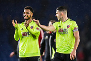 Lys Mousset (Sheffield United) & John Egan (Sheffield United) applauding the Sheffield United FC supporters following the Premier League match between Brighton and Hove Albion and Sheffield United at the American Express Community Stadium, Brighton and Hove, England on 21 December 2019.