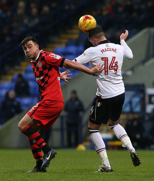 Bolton Wanderers' Gary Madine heads away from Walsall's Joe Edwards<br /> <br /> Photographer David Shipman/CameraSport<br /> <br /> The EFL Sky Bet League One -Bolton Wanderers v Walsall - Saturday 11th February 2017 - Macron Stadium - Bolton<br /> <br /> World Copyright © 2017 CameraSport. All rights reserved. 43 Linden Ave. Countesthorpe. Leicester. England. LE8 5PG - Tel: +44 (0) 116 277 4147 - admin@camerasport.com - www.camerasport.com