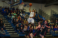 Gilford's Adrian Siravo crushes a layup against Stevens during first round tournament action for NHIAA Division III basketball Thursday evening.  (Karen Bobotas/for the Laconia Daily Sun)