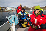 Bjornar Hogset steers his boat out to sea from Vaeroy Island, Lofoten Islands, Norway to go fishing with his American guests Parmenter and Liana Welty.