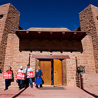 041113       Cable Hoover<br /> <br /> Ason Austin, right, Gene Salt, Micheryl Salt, Ella Tallis, Phillip Sells and others line up to protest the Navajo Generating Station proposal at the Navajo Nation Council Chambers in Window Rock Thursday.
