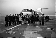 Irish Rugby Team Departs For France..1966..29.01.1966..01.29.1966..29th January 1966..The Irish rugby team departed Dublin Airport today for Saturday's meeting with France in Paris...Image shows the Irish Rugby team and officials on the tarmac at Dublin Airport as they prepare to board the St Ronan one of Aer Lingus's fleet of BAC 1-11s.