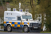 An armoured police vehicle with a CCTV on its rooftop is seen observing the loyalists march in the city entre in Antrim on Friday, April 23, 2021. This is the fourth week of subsequent protests and marches since British loyalists renounced their support to the Good Friday Agreement in March this year. (Photo/ Vudi Xhymshiti)
