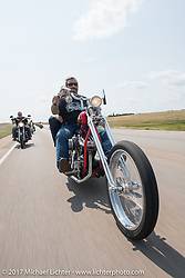 Chris and Heather Callen riding north on highway 79 on the Run to the Line for lunch and biker vs Cowboy rodeo games at the Spur Creek Ranch in Newell during the annual Sturgis Black Hills Motorcycle Rally. SD, USA. Wednesday August 9, 2017. Photography ©2017 Michael Lichter.