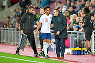 England head coach Aidy Boothroyd congratulates goal scorer Reiss Nelson (#19) of England U21s (Hoffenheim, loan from Arsenal) after he is substituted during the U21 UEFA EUROPEAN CHAMPIONSHIPS match between Scotland and England at Tynecastle Stadium, Edinburgh, Scotland on 16 October 2018.