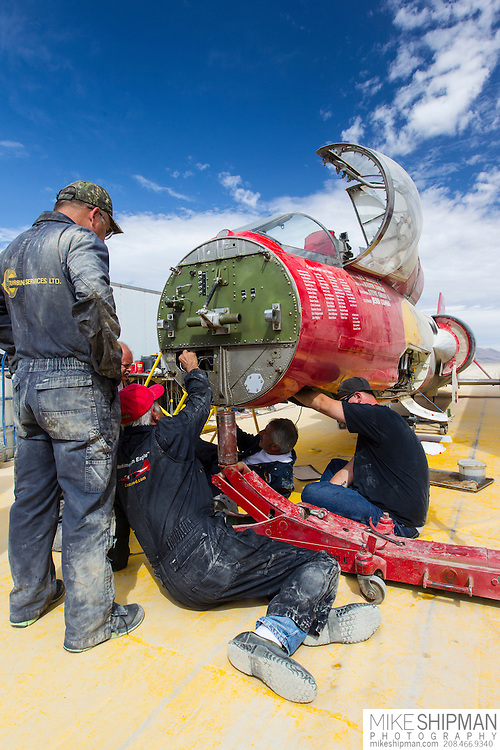 The crew of the North American Eagle make repairs to steering components in the Alvord Desert of Oregon.