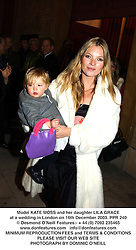 Model KATE MOSS and her daughter LILA GRACE at a wedding in London on 16th December 2003.PPR 240