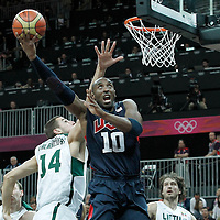 04 August 2012: USA Kobe Bryant goes for the layup past Lithuania Jonas Valanciunas during 99-94 Team USA victory over Team Lithuania, during the men's basketball preliminary, at the Basketball Arena, in London, Great Britain.