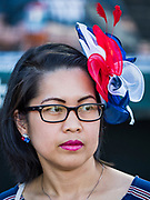 04 JULY 2019  - DES MOINES, IOWA: MJ VENTURA LIBANAN, originally from the Philippines, waits for her naturalization ceremony to start before the Iowa Cubs game. Thirty people became US citizens during a naturalization ceremony at the Iowa Cubs game in Des Moines. The naturalization ceremony is an Iowa Cubs 4th of July tradition. This is the 11th year they've held the ceremony.          PHOTO BY JACK KURTZ