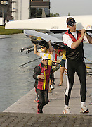 Munich, GERMANY, 2006, GER men's eight cox Peter Thiede, watch's as the German eight is carried from the boating dock, oarsman, Thorsten Englemann, carrying, at the FISA, Rowing, World Cup, held on the Olympic Regatta Course, Munich, Thurs. 25.05.2006. © Peter Spurrier/Intersport-images.com,  / Mobile +44 [0] 7973 819 551 / email images@intersport-images.com.[Mandatory Credit, Peter Spurier/ Intersport Images] Rowing Course, Olympic Regatta Rowing Course, Munich, GERMANY