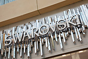 Sign for the clothing brand and accessory shop Swarovski in Birmingham, United Kingdom.