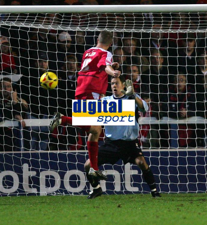 Photo: Frances Leader.<br />Peterborough Utd v Leyton Orient. Coca Cola League 2.<br />12/11/2005.<br />Orients Justin Miller scores a goal past Borough's goalie Mark Tyler and equalises.