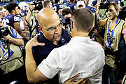 Penn State Nittany Lions head coach James Franklin and Memphis Tigers head coach Ryan Silverfield come together after the game of the NCAA Cotton Bowl Classic football game, Saturday, Dec. 28, 2019 at AT&T Stadium in Arlington, Texas. Penn State defeated Memphis 53-39. (Mario Terrana/Image of Sport)