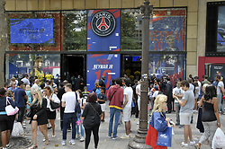 Customers queue at the entrance to the Paris-Saint-Germain (PSG) football club store on the Champs Elysees avenue in Paris, France, on August 4, 2017, after Brazilian footballer Neymar's arrival in the French capital. Paris Saint-Germain have signed Brazilian forward Neymar from Barcelona for a world-record transfer fee of €222 million, more than doubling the previous record. Photo by Alain Apaydin/ABACAPRESS.COM