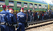 Migrants are seen at Bicske train station in Hungary as a tense stand-off between police and migrants  continues into a second day. On Thursday, police let the migrants board the train in Budapest but then tried to force them off at a refugee camp to the west of the capital.