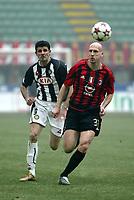 Milano 16-01-2005<br />Campionato  Serie A Tim 2004-2005<br />Milan Udinese<br />nella  foto Vincenzo Iaquinta Udinese (L), Jaap Stam Milan (R)<br />Foto Snapshot / Graffiti