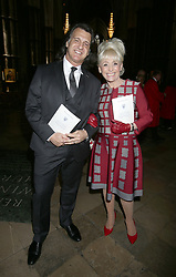 Dame Barbara Windsor and husband Scott Burnet in Westminster Abbey, London after the Service of Thanksgiving for the Life and Work of the Ronnie Corbett who died last year.