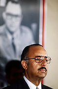 """Nicaraguan President Anastasio """"Tachito"""" Somoza Debayle, stands in front of a portrait of his father - former Nicaraguan President  Anastasio Somoza García who was assassinated in 1956. Somoza - the younger - was himself assassinated in<br /> Asunción, Paraguay on September 17, 1980 after resigning as president and fleeing to first the USA and then Paraguay."""