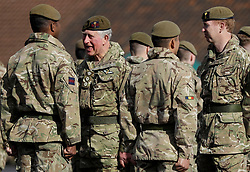 The Prince of Wales (second left), Colonel Welsh Guards, presents campaign medals to soldiers from the 1st Battalion Welsh Guards at Elizabeth Barracks, Pirbright Camp in Woking, following their return from Afghanistan.