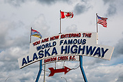 """Mile 0 of the Alaska Highway, at Dawson Creek, in British Columbia, Canada. The Alaska Highway was built as a military road during World War II in just 9 months in 1942, to link existing airfields via Canada to the territory of Alaska. The ALCAN Highway (a military acronym for Alaska-Canada) opened to the public in 1948. It begins in Dawson Creek, British Columbia, and runs via Whitehorse, Yukon to Delta Junction, Alaska. The """"Alaskan Highway"""" is comprised of British Columbia Highway 97, Yukon Highway 1 and Alaska Route 2. While the ALCAN measured 2700 kilometers (1700 mi) upon completion in 1942, by 2012 it was rerouted and shortened to 2232 km (1387 mi). Once legendary for being a rough, challenging drive, the highway is now paved over its entire length. Delta Junction, at the end of the highway, claims """"Historic Milepost 1422"""" where the Alaska Highway meets the Richardson Highway, which continues 96 mi (155 km) to the city of Fairbanks at Historic Milepost 1520, often (but unofficially) regarded as the northern portion of the Alaska Highway (although its Mileposts are measured from Valdez)."""