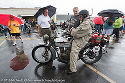 Bill Page of KS talks with spectators at the hosted lunch in Parsons, Kansas where the remainder of the days ride was cancelled due to severe weather during the Motorcycle Cannonball Race of the Century. Stage-7 from Springfield, MO to Wichita, KS. USA. Friday September 16, 2016. Photography ©2016 Michael Lichter.