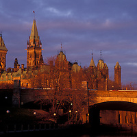 Canada, Ontario, Ottawa, Canadian Houses of Parliament Building along Rideau Canal at sunrise on autumn morning