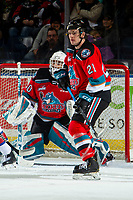 KELOWNA, BC - NOVEMBER 26:  Jake Lee #21 looks for the shot as Roman Basran #30 of the Kelowna Rockets defends the net against the Edmonton Oil Kings at Prospera Place on November 26, 2019 in Kelowna, Canada. (Photo by Marissa Baecker/Shoot the Breeze)