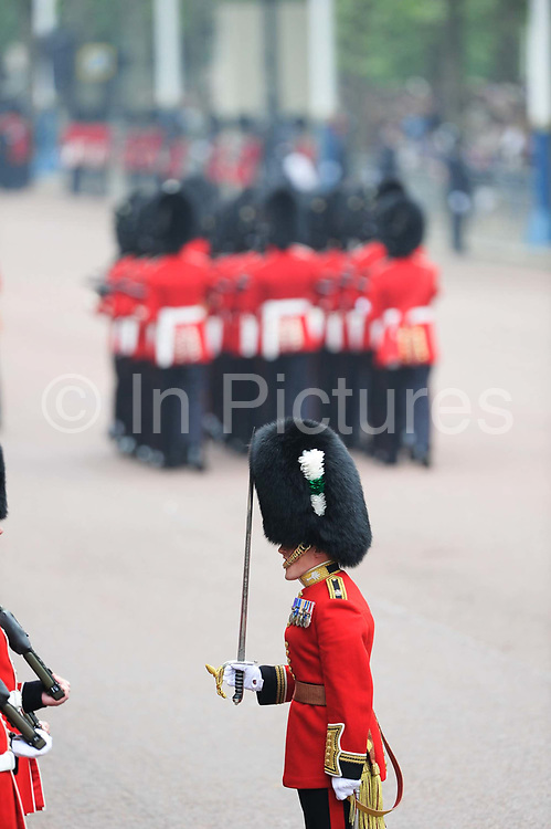 The Royal Wedding of Prince Charles and Kate Middleton, London 29th April 2011. Crowds gathered to line the streets on this important day for the Royal Family. Grenadier Guards make an atmosphere of pomp and ceremony on the big day on The Mall in central London.